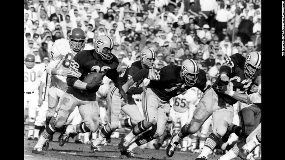 "Elijah Pitts (#22) running the Packers' ""power sweep,"" Super Bowl I, 1967."
