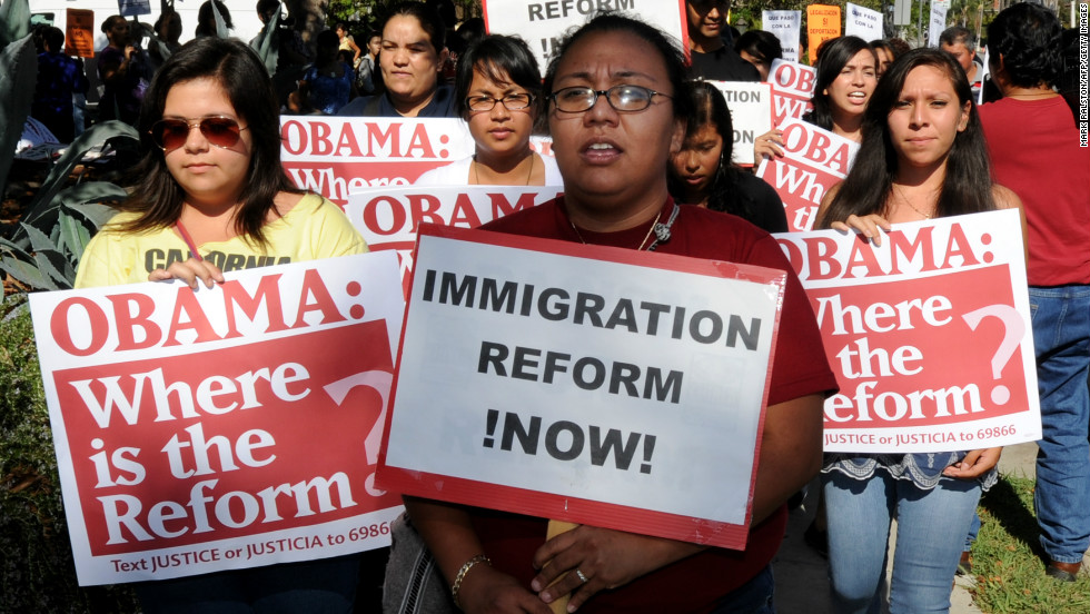 Immigration-rights activists stage a rally calling for the government to act on immigration legislation, outside the venue of President Barack Obama's Democratic Congressional Campaign Committee fundraiser in Los Angeles on August 16, 2010. President Barack Obama recently signed a bill that tightens security at the Mexico border, hoping to address the hot issue of illegal immigration in the run-up to November congressional elections. The 600-million-dollar legislation hikes visa fees for some IT workers entering the United States, and has had been slammed by Indian industry. The fee increases pay for 1,000 new US Border Patrol agents to form a 'strike force' for quick deployment, 250 new Immigration and Customs Enforcement agents as well as 250 new Customs and Border Protection officers at ports of entry. It also boosts communications among law-enforcement officials. AFP PHOTO / Mark RALSTON (Photo credit should read MARK RALSTON/AFP/Getty Images)