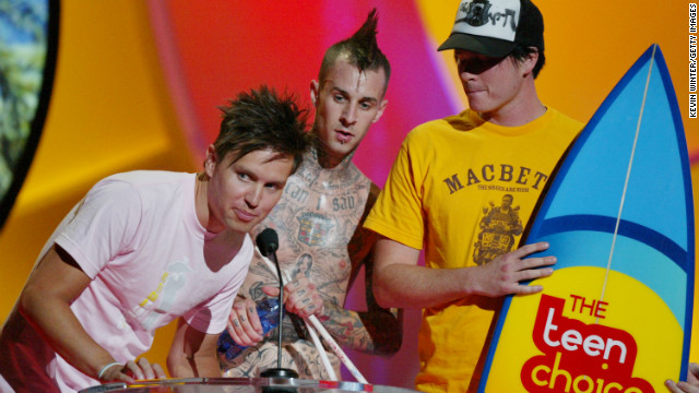 UNIVERSAL CITY, CA - AUGUST 8: 'Choice' Love Song' winners, Blink 182 speak on stage at The 2004 Teen Choice Awards held on August 8, 2004 at Universal Amphitheater, in Universal City, California. (Photo by Kevin Winter/Getty Images)