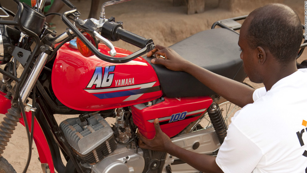Jallow starts his day by carrying out a daily maintenance check on his motorbike to ensure it is working properly. RFH trains all health workers to conduct simple checks on their vehicles.