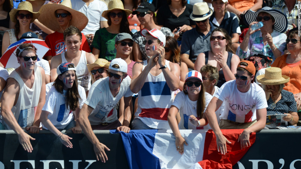 Spectators cheer for France's Jo-Wilfried Tsonga during his men's singles match against Japan's Go Soeda on January 17. Tsonga defeated Soeda 6-3, 7-6(1), 6-3.