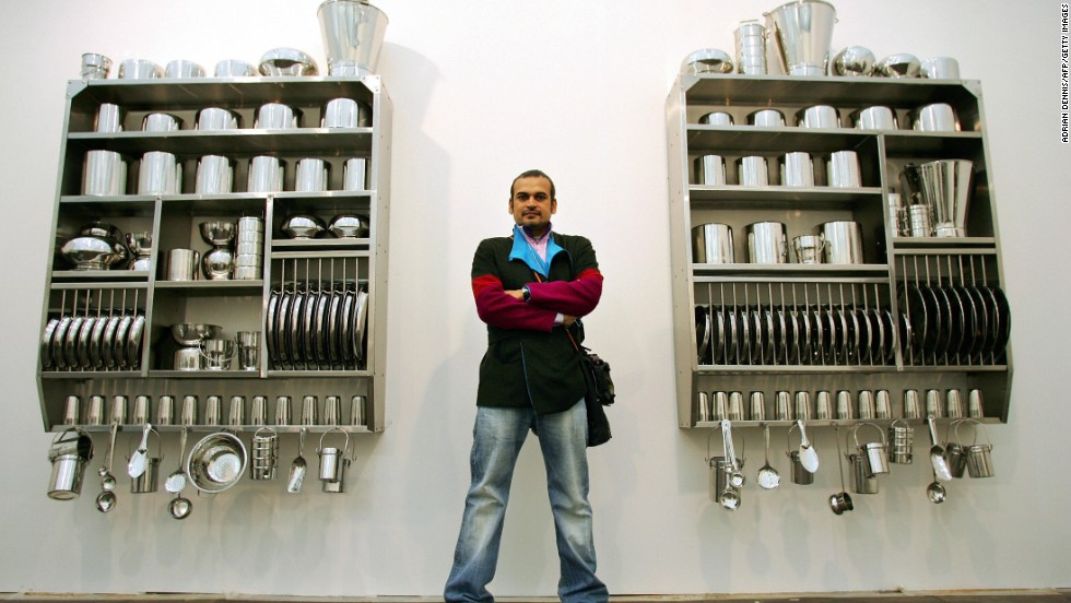 Shortly after arriving in India she fell in love with her husband, Subodh Gupta. Gupta is also a well-known artist -- here he stands by his artwork at Frieze Art Fair in 2005.