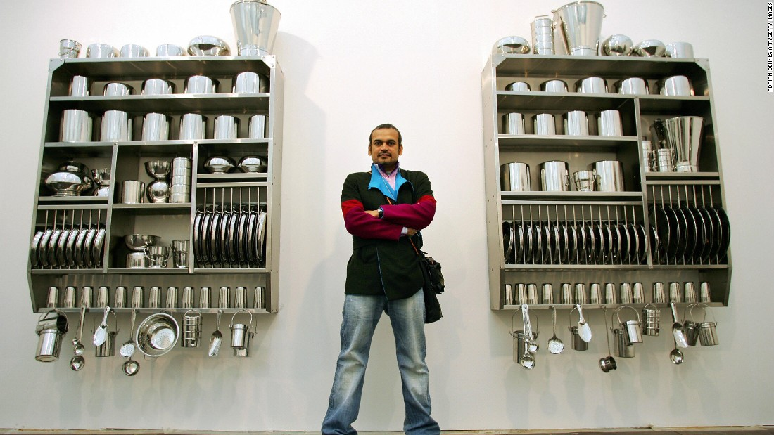 Subodh Gupta, Bharti Ker's husband, is also a well-known artist. Here he stands by his artwork at Frieze Art Fair in 2005.