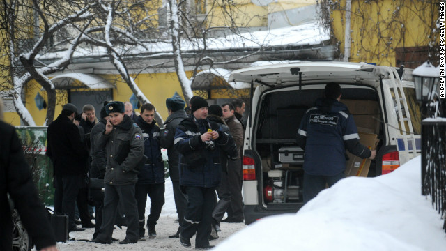 Police look at the scene where a reputed Russian mafia kingpin was fatally shot outside a Moscow restaurant Wednesday.