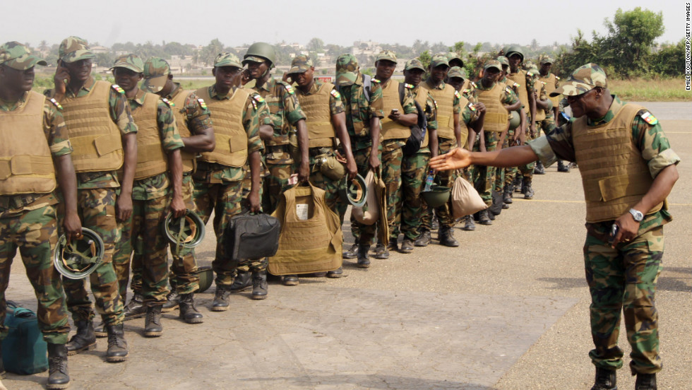 Togolese troops board a plane to Bamako, Mali, on Thursday, January 17, at the Lome airport in Togo. Troops from West African countries are heading to Mali as part of a U.N.-mandated African force to fight the insurgents.