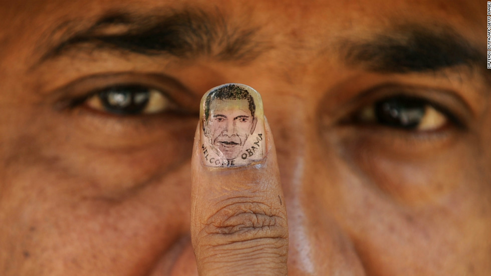 INDIA: Micro-artist Ramesh Sah shows the nail of his thumb painted with an image of Obama in Siliguri on November 6, 2010.
