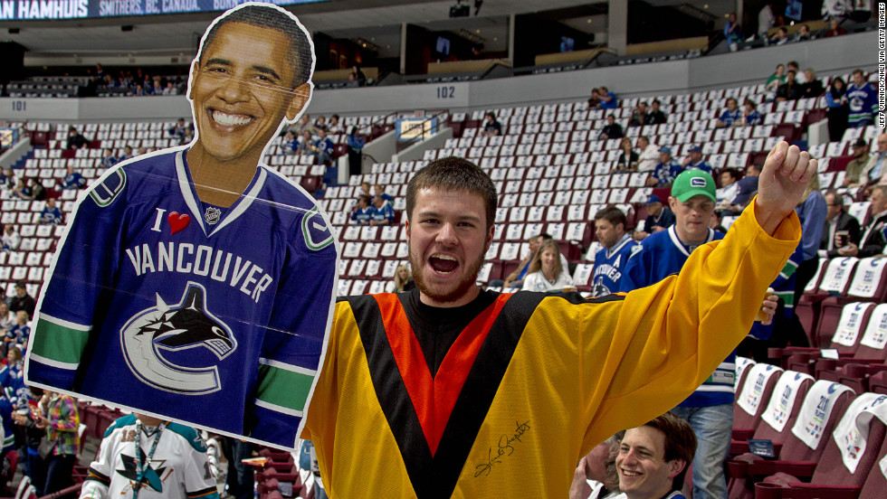 CANADA:  A Canucks fan holds a cutout of Obama before the Canucks take on the San Jose Sharks in Game Five of the Western Conference Finals during the 2011 NHL Stanley Cup Playoffs on May 24, 2011, in Vancouver, British Columbia.