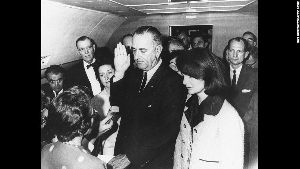 Lyndon B. Johnson takes the oath of office aboard Air Force One after the assassination of John F. Kennedy in November 1963. Standing on the right is Kennedy's widow, Jackie.