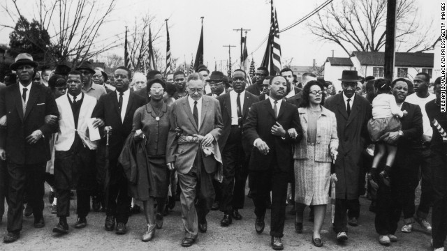 Martin Luther King and his wife, Coretta King, lead a voting rights march from Selma to Montgomery, Alabama, in March 1965.