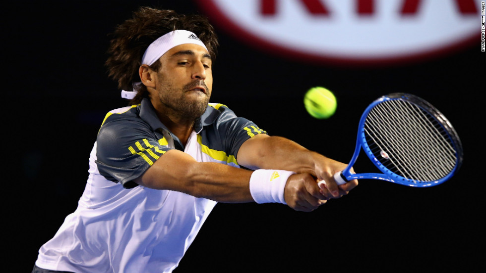 Baghdatis plays a backhand during his third-round match against Ferrer on January 18.