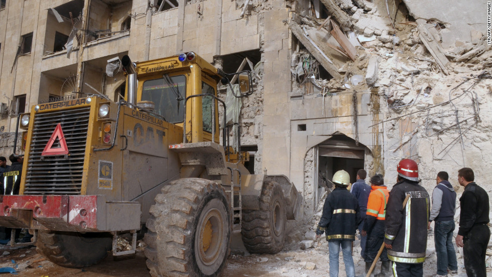 Emergency personnel inspect the scene of an explosion in Aleppo, Syria, on January 18.