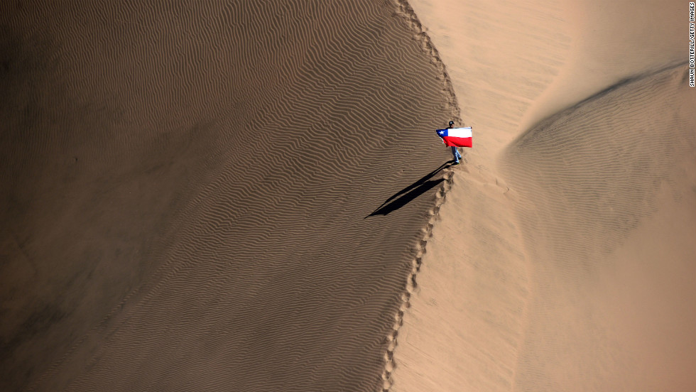 A Chilean supporter waits for the competitors during stage 13 from Copiapo to La Serena on Friday, January 18 in Copiapo, Argentina.