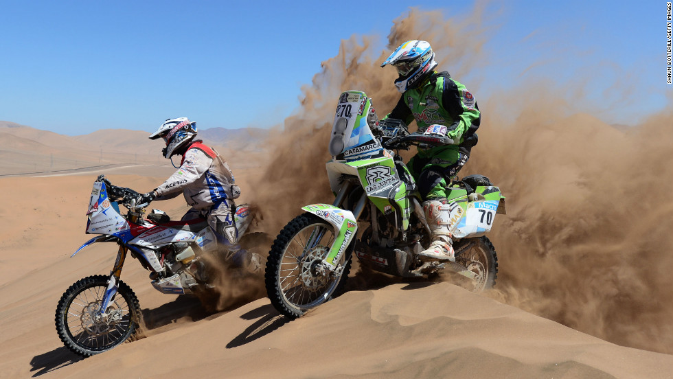 Diego Demelchori and Simon Pavey race over a dune on January 18 in Copiapo, Argentina.