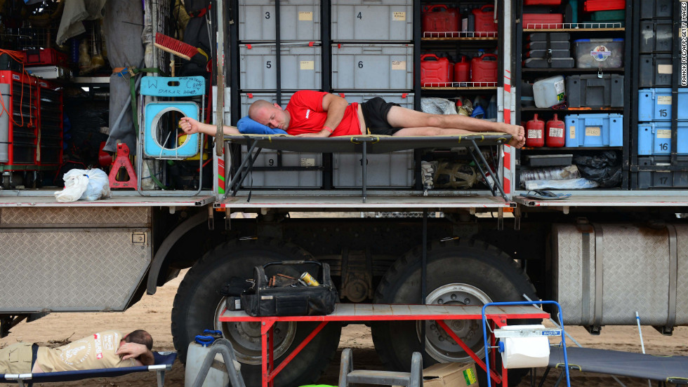 A mechanic rests on a truck on January 18.