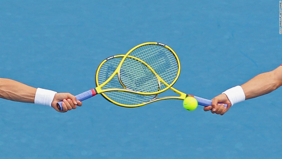 The racquets of Bob Bryan of the United States and Mike Bryan of the United States cross as they compete in their men's second round doubles match against Flavio Cipolla of Italy and Andreas Seppi of Italy on Friday, January 18. The Bryan brothers won 6-3, 6-4.