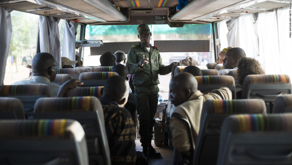 Malian soldiers check the identity of passengers in a bus coming from Mopti on January 19.