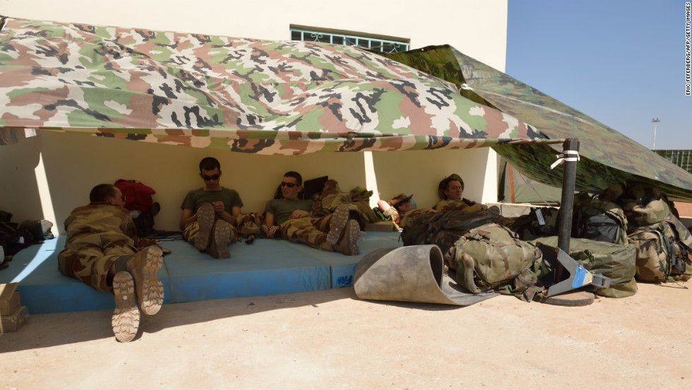 French soldiers of the 5th Combat Helicopter Regiment  relax on January 19 at the airbase near Bamako.