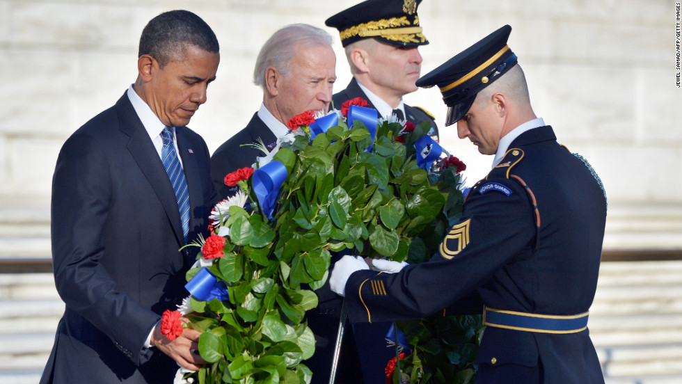 Obama and Biden lay a wreath at the Tomb of the Unknowns at Arlington National Cemetery in Arlington, Virginia, on January 20.