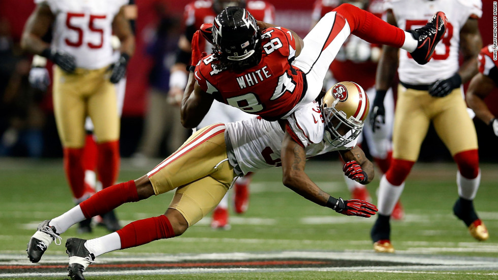 Dashon Goldson of the 49ers hits Falcons receiver Roddy White on Sunday.