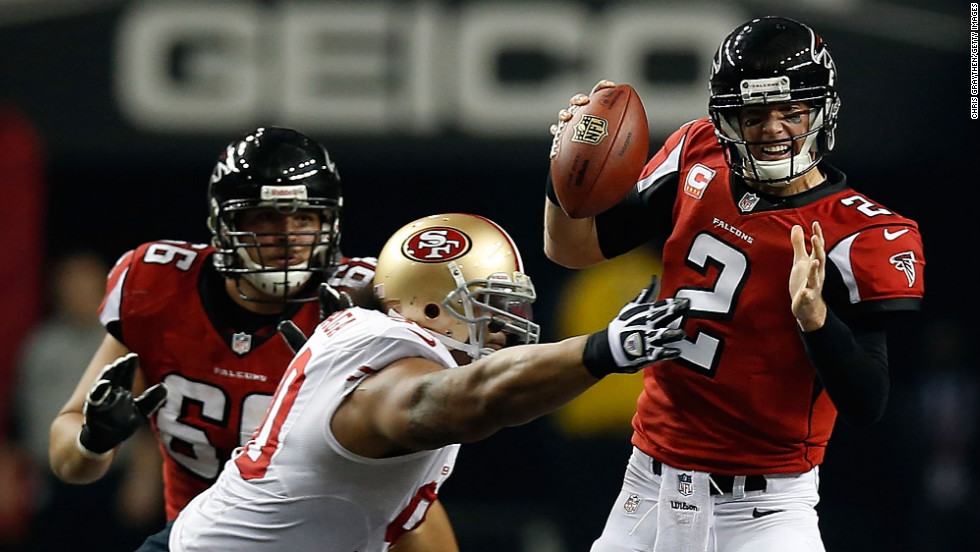 Falcons quarterback Matt Ryan holds onto the ball as he is tackled by Isaac Sopoaga of the San Francisco 49ers.