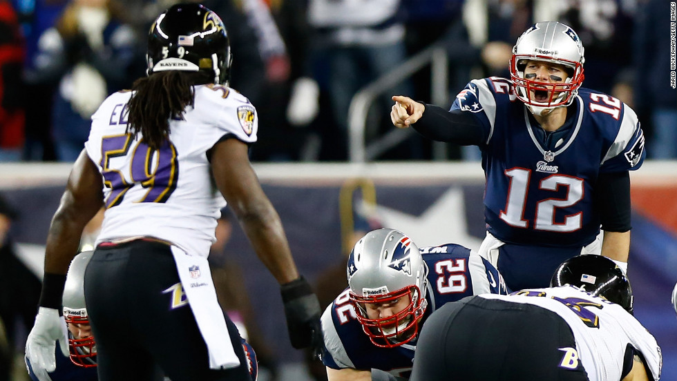 Patriots quarterback Tom Brady makes an adjustment at the line against the Ravens.