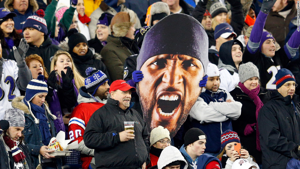 A Baltimore Ravens fan holds up a giant photo of linebacker Ray Lewis' face.