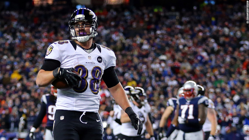 Dennis Pitta of the Baltimore Ravens catches a touchdown pass in the third quarter.