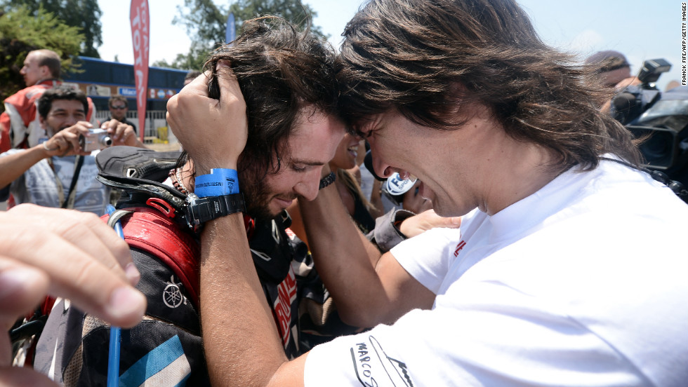 Argentinian ATV driver Marcos Patronelli, left, is congratulated by his brother Alejandro Patronelli after the 14th stage of the rally between La Serena and Santiago, Chile, on Saturday, January 19. Patronelli finished third in the final stage of the competition.