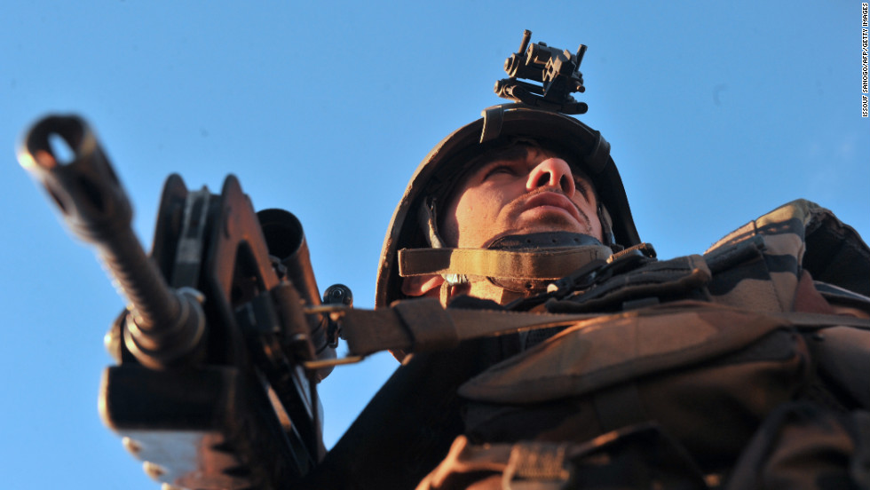 A French soldier looks around after arriving in Diabaly on January 21.