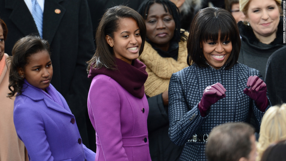 Michelle Obama arrives with daughters Sasha, left, and Malia for the inauguration on January 21.