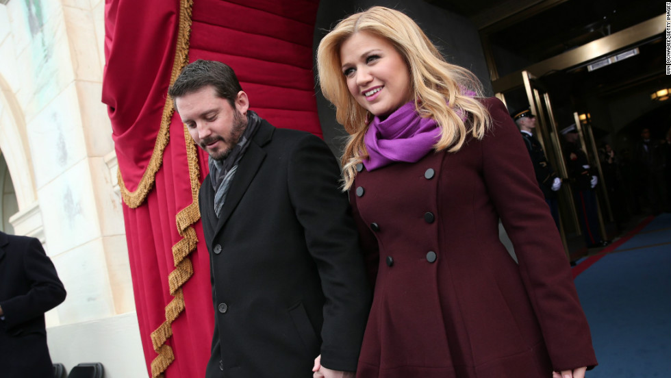 Kelly Clarkson and fiance Brandon Blackstock arrive at the presidential inauguration.