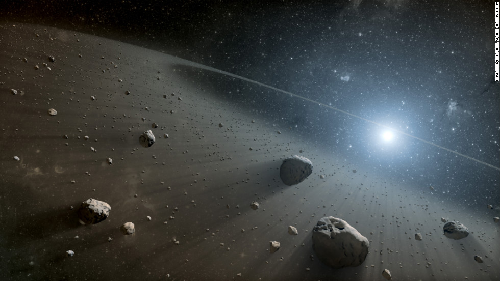 Astronomers say they have discovered an asteroid belt around the star Vega, seen in this illustration. NASA's Spitzer space telescope and the European Space Agency's  Herschel Space Observatory were used to observe the star, which is the second brightest in the northern sky.