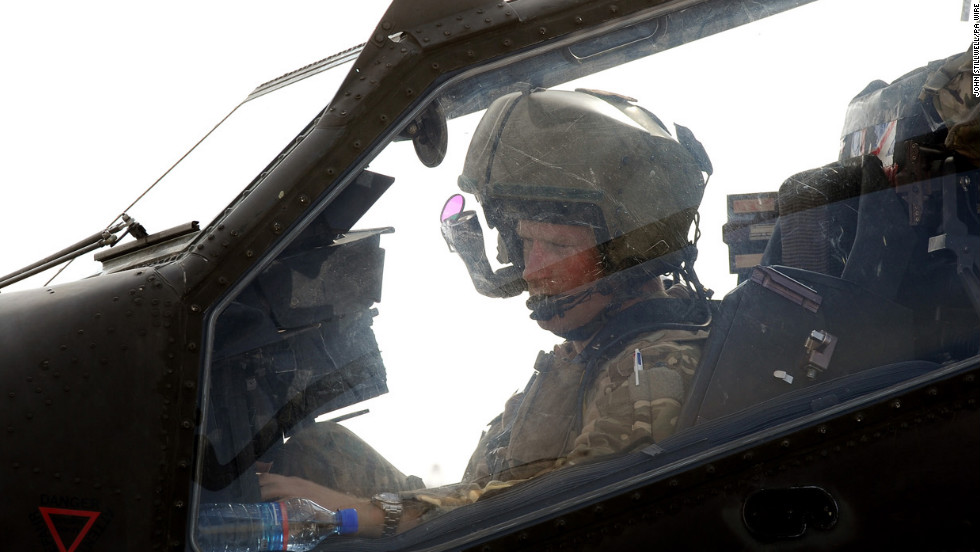 Harry sits inside an Apache helicopter at Camp Bastion on October 31, 2012.