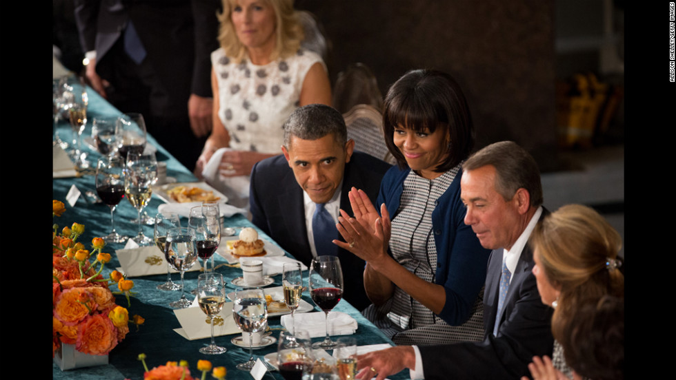President Obama shares a moment with House Speaker John Boehner, second from right, as first lady Michelle Obama applauds at the inaugural luncheon in Statuary Hall on Inauguration Day at the U.S. Capitol building on Monday.