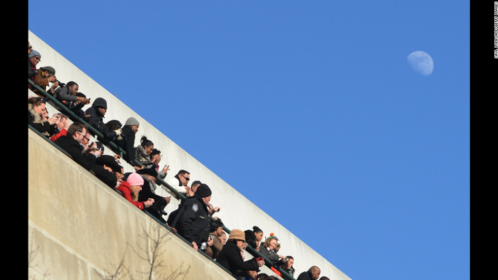 Spectators watch as the president and first lady travel along Pennsylvania Avenue on January 21.