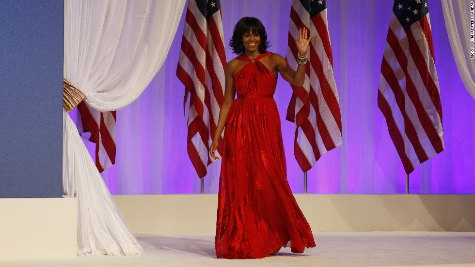 Michelle Obama is introduced at the Commander-in-Chief's Ball on Monday. She wore a floor-length, custom, ruby-colored chiffon and velvet gown designed by Jason Wu, the same designer behind her 2009 inaugural dress.