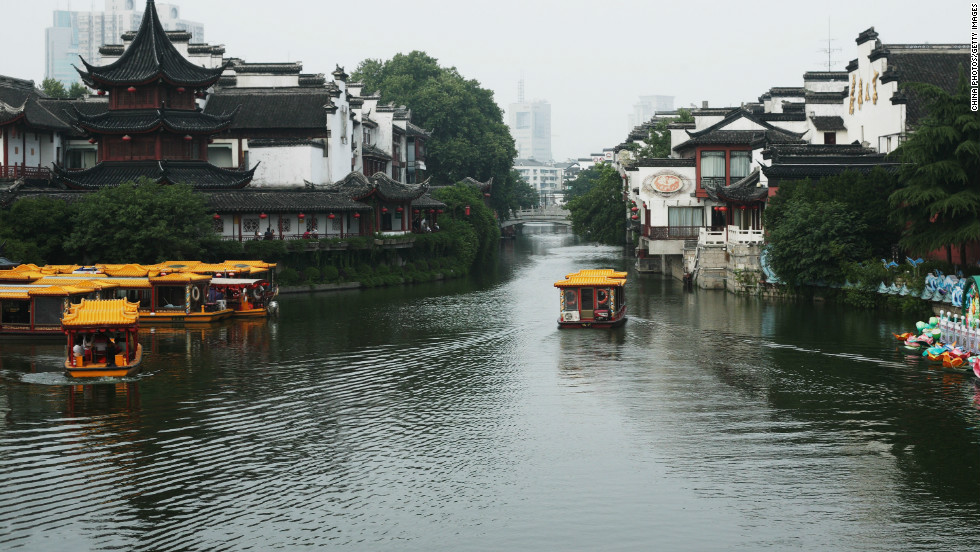 Sightseeing boats on the Qinhuai River pass close to Nanjing's Confucius Temple -- an example of the city's diverse architecture.