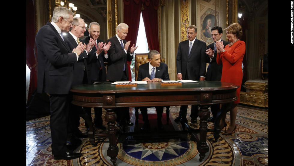 Senate and House leaders and Vice President Joe Biden applaud the president after he signs a proclamation to commemorate the inauguration on January 21.