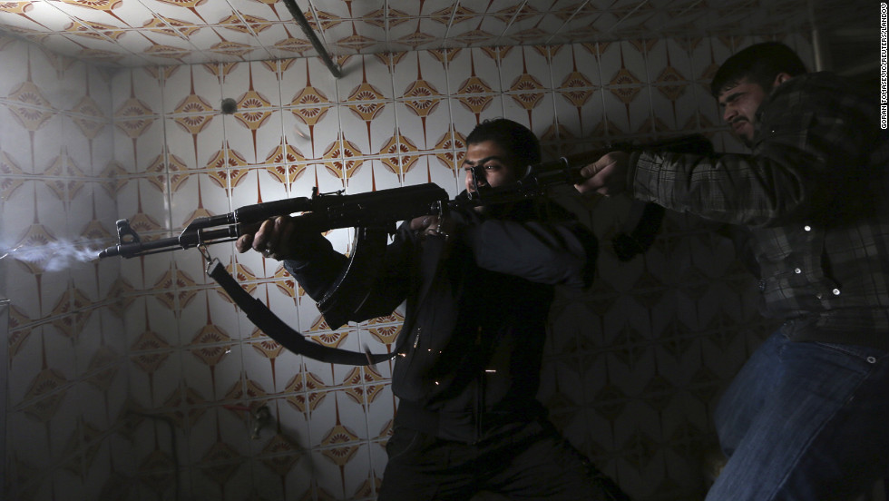 Fighters fire rifles on Syrian Army soldiers at a check point in Haresta neighborhood of Damascus on January 20.