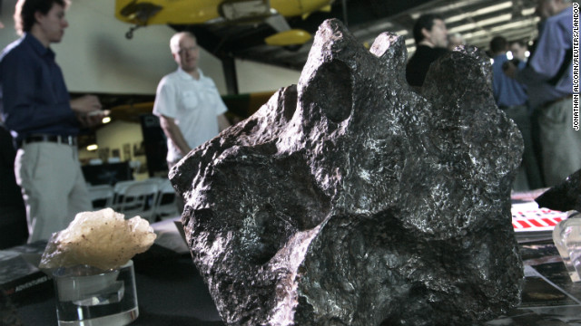 Meteorites sit on a display table Tuesday at the Deep Space Industries announcement of plans for the world's first fleet of commercial asteroid-prospecting spacecraft at the Museum of Flying in Santa Monica, California.