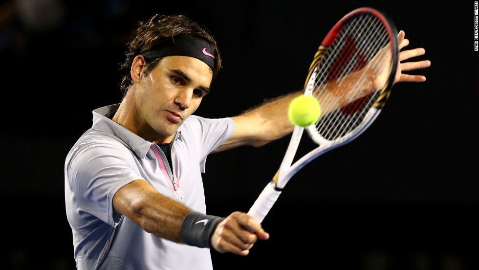 Federer plays a backhand to Tsonga on January 23.