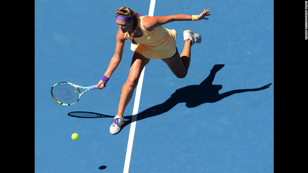 Victoria Azarenka of Belarus hits a return against Russia's Svetlana Kuznetsova on January 23. Azarenka defeated Kuznetsova 7-5, 6-1.