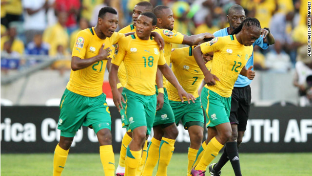South Africa's players celebrate on their way to a 2-0 win over Angola in Durban Wednesday.