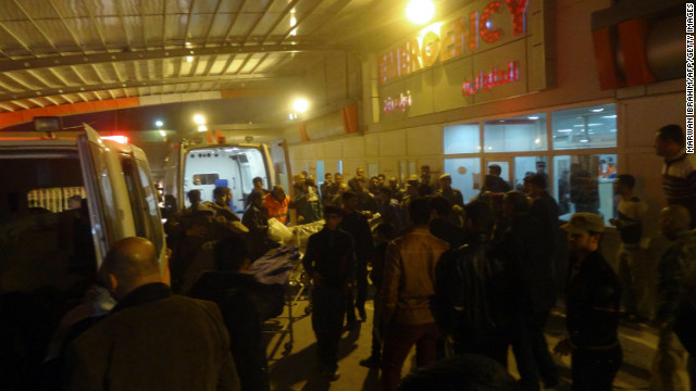 People gather around the entrance of a hospital in Kirkuk, north of Baghdad, on Wednesday, after suicide bombing attack.