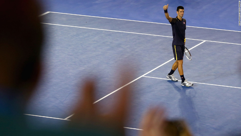 Novak Djokovic of Serbia celebrates winning his semifinal match against David Ferrer of Spain during the Australian Open in Melbourne on Thursday, January 24. Djokovic won 6-2, 6-2, 6-1.