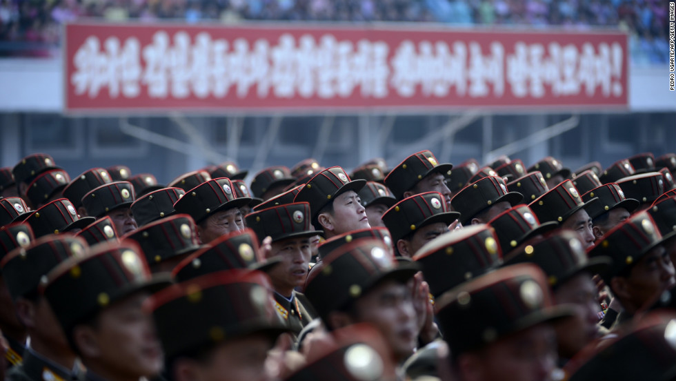 North Korean soldiers listen to a speech during an official ceremony attended by leader Kim Jong Un at a stadium in Pyongyang in April 2012.