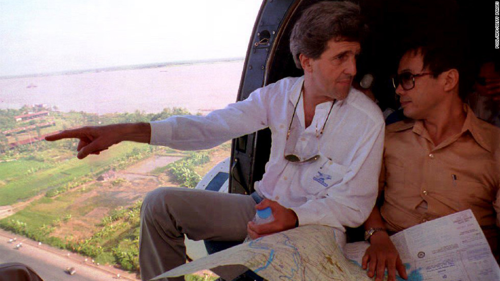 Kerry looks over a map with Nguen Xuan Phong of the Vietnamese Foreign Ministry while flying over the Mekong River Delta on November 20, 1992.