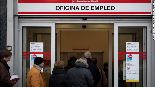People queue to enter a government employment office as it opens on December 4, 2012 in Madrid, Spain.