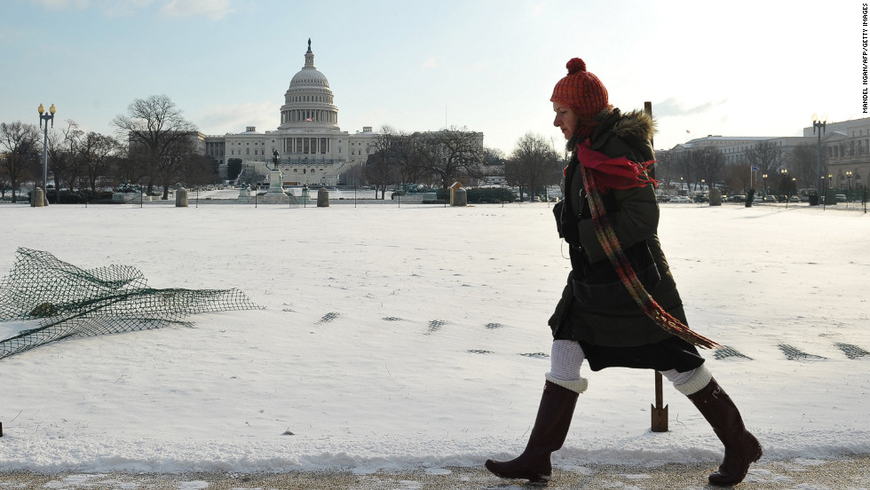 The U.S. Capitol in Washington is blanketed with snow on January 24. The same brutal Arctic cold front that's delivered subzero temperatures across the upper Midwest and Northeast is forecast to bring ice and freezing rain to the South and Mid-Atlantic states.