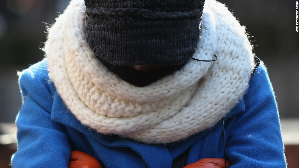 A pedestrian bundled up against the cold walks along a street in Manhattan on January 24.